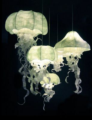 Amazing jellyfish lamps by Gerladine Gonzalez. Have a look at her website, she does really nice shop-windows too. http://www.geraldinegonzal...