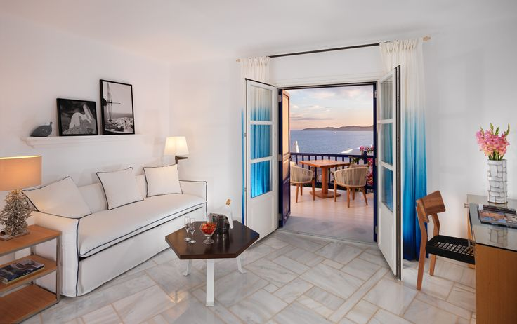 The Sea View Suites with separate living room are sumptuous Mykonos Grand luxury Hotel & Resort suites consisting of a spacious bedroom and a separate living room that can also accommodate 2 more guests on a sofa bed. Each Sea View Suite with separate living room is an oasis of luxurious idleness embodying the island's stylish taste with cool Dionysos marble floors, furniture and decorative lighting is elegant and streamlined, recalling mid-twentieth century styling.