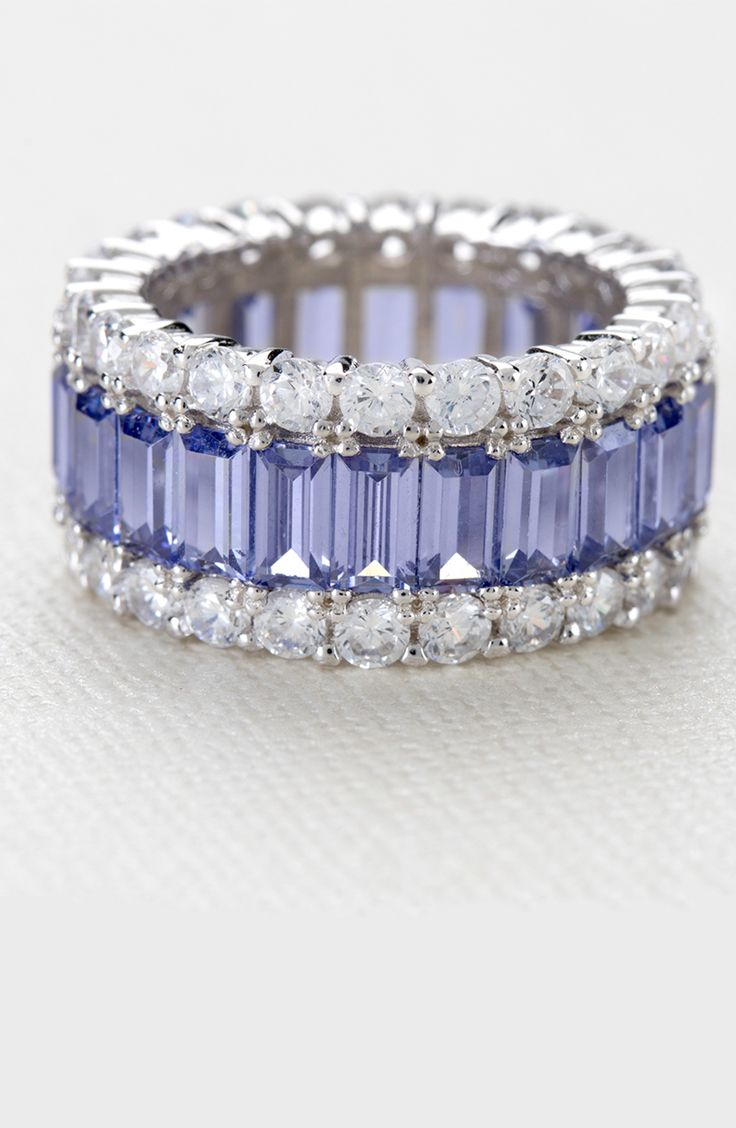 A circle has no end - just like the dazzle on this ring! No end in sight! Eternity bands are for those who never give up on shining for all time. | Tanzanite Simulant & White Dia Sim 11.25ctw Rhodium Plated Silver Ring
