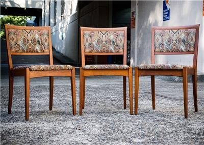 Parker teak dining side chairs made in 1983. Seats refurbished with original tapestry upholstery. Designed c1975-78