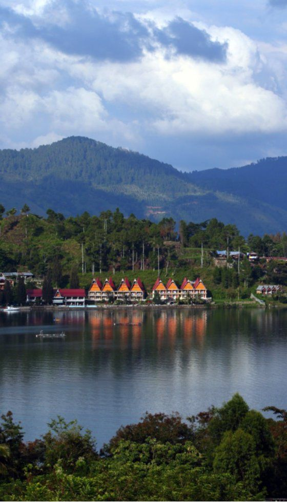 View overlooking Lake Toba in Indonesia. You can see the traditional Batak houses by the lakeside.