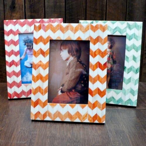 Chevron picture frames - i had a dream that i should make these! ill try to find scrapbook paper for my bedroom colors (coral, pink, teal, grey). hobby lobby has unfinished wood picture frames. edge it with medium grey paint.