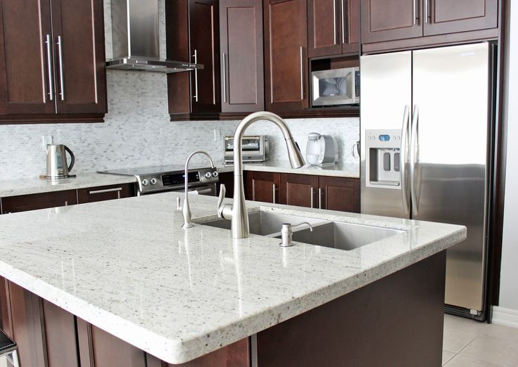 Kashmir white granite with cherry color cabinets