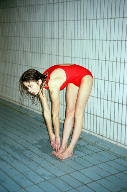 This pose but wearing something unusual to dive into the water with - perhaps that red glass top that we have? Her bottom can even be nude for this pose since you don't actually see anything. RED GLASS TOP (La Piscine - Jacquemus)