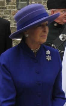Princess Alexandra, The Honourable Lady Ogilvy  is the youngest granddaughter of King George V and Mary of Teck. She is the widow of Sir Angus Ogilvy. Prior to her marriage she was known as Princess Alexandra of Kent, being the first princess to use the territorial designation of Kent since Princess Alexandrina Victoria of Kent's accession as Queen Victoria. Princess Alexandra carries out royal duties on behalf of her cousin, Queen Elizabeth II.