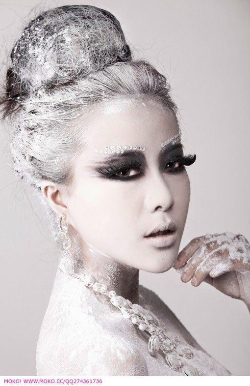 Bejeweled eye brows highlight dark grey eye shadow in this fantasy make-up look.