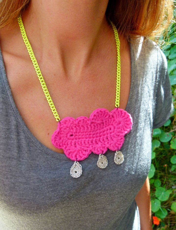 Neon pink Happy Cloud necklace with silver thread raindrops. Handmade in Aotearoa NZ. www.facebook.com/thelittlebeenz www.etsy.com/shop/thelittlebeenz http://instagram.com/thelittlebeenz www.twitter.com//thelittlebeenz