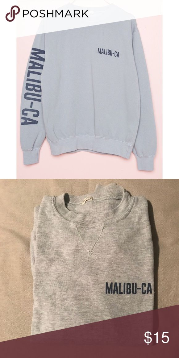 Brandy Melville Sweatshirt- Malibu CA Grey with blue lettering. I posted a photo from there website for reference however mine doesn't have any writing on the sleeves. It's plain grey with the logo in the front. So soft and cozy- really good quality for Brandy Melville! Worn a few times but in great condition. One size fits all Brandy Melville Tops Sweatshirts & Hoodies