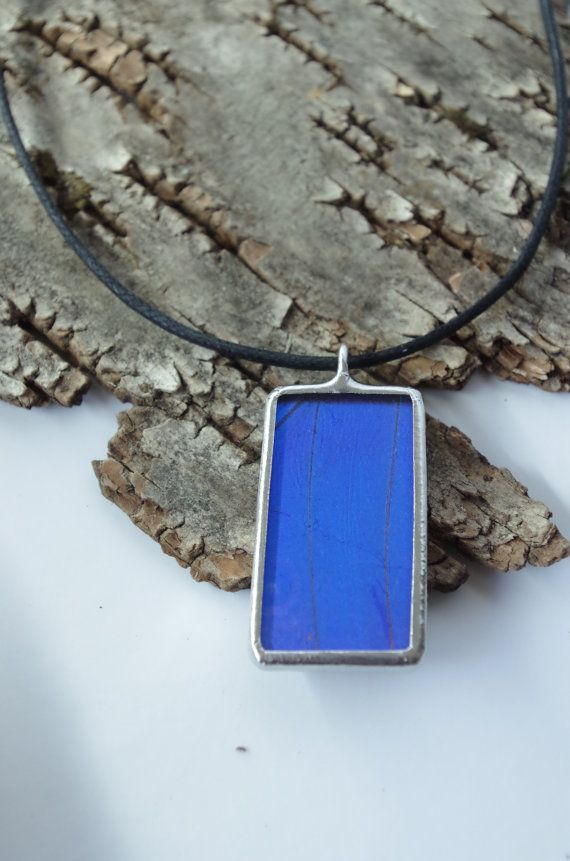 This pendant is made using a real butterfly wing. The Blue Morpho (Morpho didius) is probably the most famous blue butterfly, the iridescent