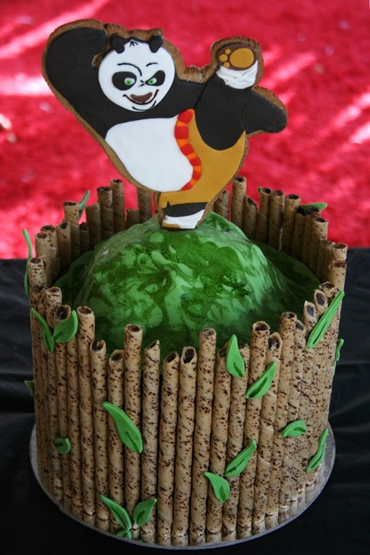 Kung Fu Panda Cake - snake lollies mountain and choc wafer 'bamboo'. http://www.facebook.com/pages/Fun-with-Fondant/201976469840053
