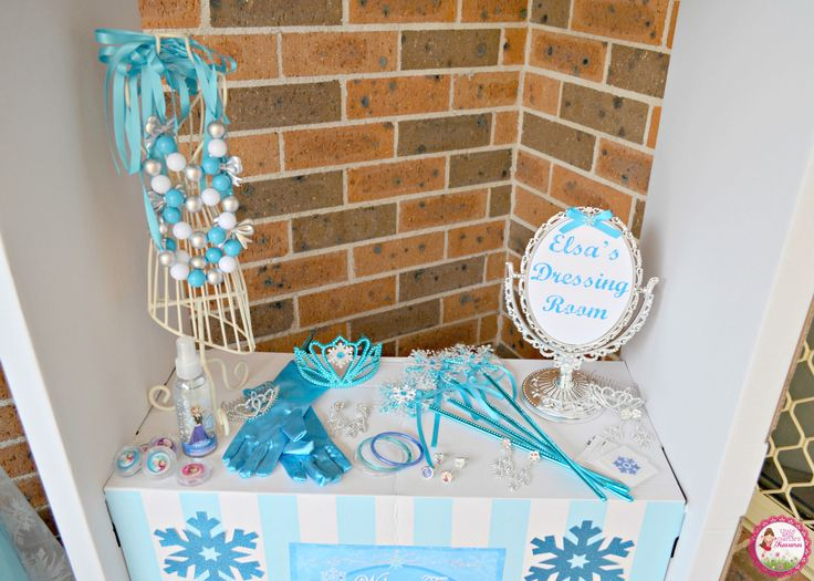 Frozen Party idea - 'Elsa's Dressing Room' with dress up Elsa and Anna costumes, jewellery, snowflake wands, crowns and lip gloss by Little Miss Charlie's Treasures