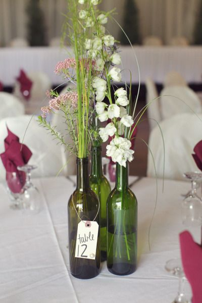Wine bottle centerpieces for wedding daniella quince for Wine bottle ideas for weddings