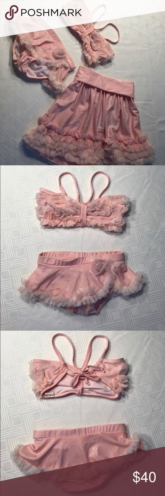 🎉BOGO 1/2 OFF🎉Frankie & Daisy 3pc. pink swimsuit Beautiful Frankie & Daisy 3pc.Girls pink swimsuit size 7. This beautiful bikini bathing suit with matching skirt is made with sparkly light pink fabric, silver and pink sparkly mesh, and soft tulle. It is sure to be a show stopper! :) Frankie & Daisy (Corky & Company) Swim Bikinis