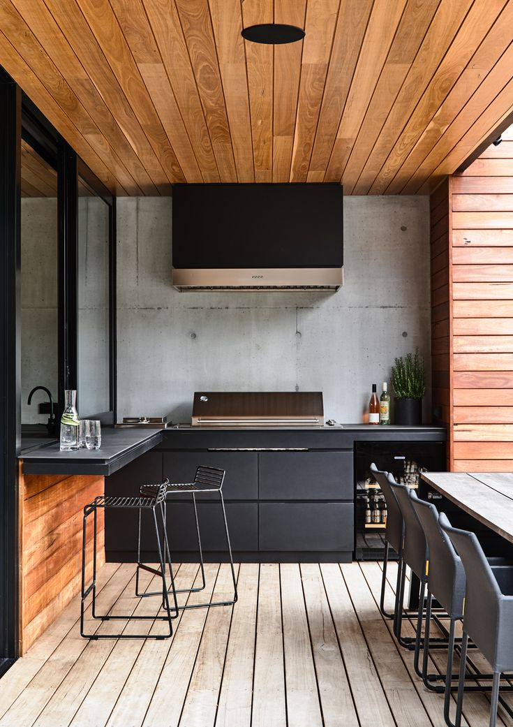 Designed by Acre - Munro Street. www.acre.com.au Photo by Derek Swalwell. Construction by Powda. Outdoor kitchen with BBQ and Mamagreen furniture
