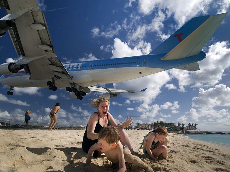 [St. Maarten] Landing at Princess Juliana International Airport, a looming 747 thrills visitors on Mahó beach, a famous plane-watching spot.