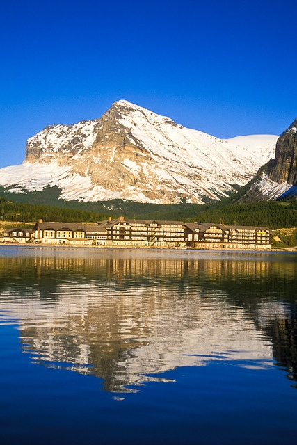 The Many Glacier Hotel reflected in Swiftcurrent Lake. Glacier National Park, Montana.  Photo: Jerry Mercier via Flickr