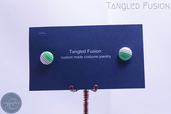 Quirky Handmade Stripe Stud Earrings https://www.etsy.com/au/listing/524264472/quirky-handmade-stripe-stud-earrings?ref=shop_home_active_9  Handmade stripe stud earrings with acrylic and silver plate findings   Colour: 1/2 Green & 1/2 White Stripe   Tangled Fusion offers a wide scope of quirky, fun jewellery and handmade creations