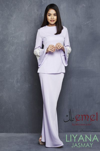 EMEL X LIYANA JASMAY - LILY - MODERN KURUNG WITH SEQUIN BELL SLEEVE (PURPLE)  This soft and sweet modern baju kurung is the perfect pastel piece for Raya. It features the textured matte sequin on the sleeves for an added glamour.