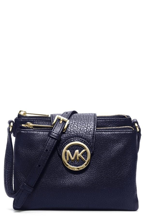 In love with this navy Michael Kors crossbody for every season.