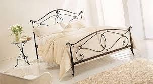 Resultado de imagen para camas de madera y hierro forjado