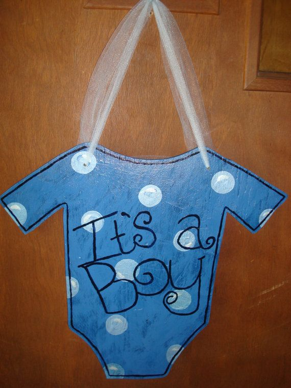 Wooden Door Decoration 'It's A Boy' or 'It's A Girl' Onesie on Etsy, $25.00