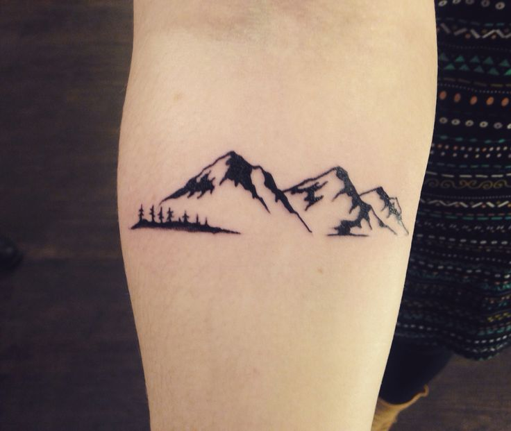 something like this of Pagosa Peak in Pagosa Springs,Co. maybe with the trees on the forearm included. mtn peak in the background