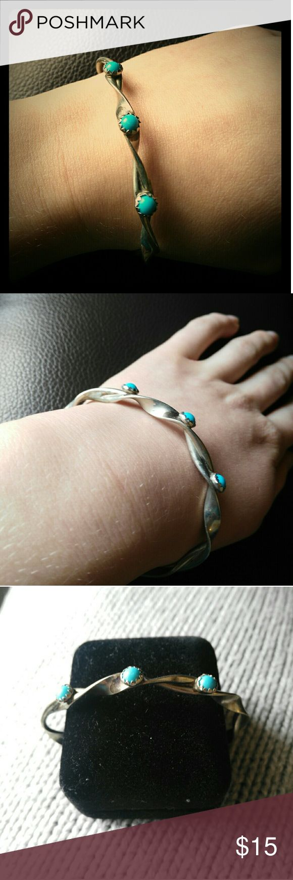 Twisted hand made turquoise bracelet Got in New Mexico, hand made and twisted. A very unique piece. Don't let this pass you by. This would be perfect to wear it with tribal leggings and a loose white shirt and ankle boots. Handmade Jewelry Bracelets