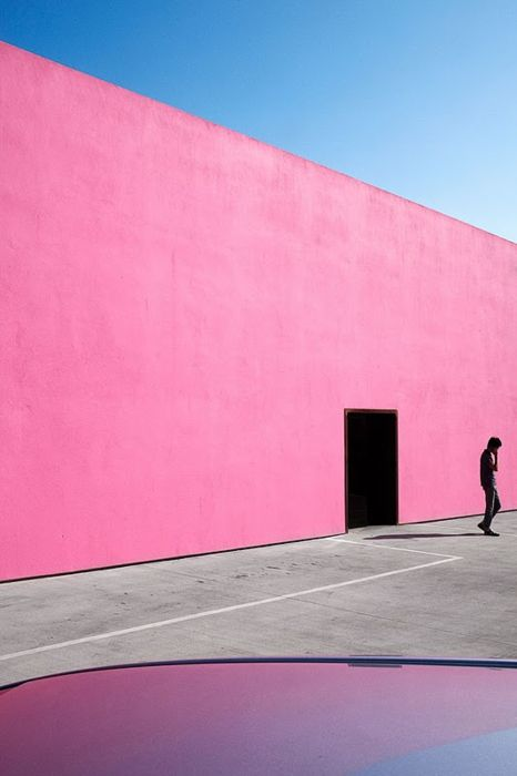 composition, contrast... the pink wall is a true contrast in comparison to the shadow of the man standing in the front right corner.