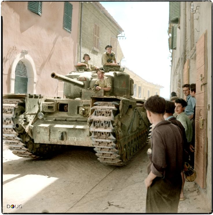 A British Army Churchill IV (NA 75) tank of 'A' Squadron, 'The North Irish Horse' attached to the 25th Tank Brigade passing through Via XX Settembre, a narrow street in Montefiore Conca in Rimini, Italy on the 11th September 1944. (© IWM NA 18530)