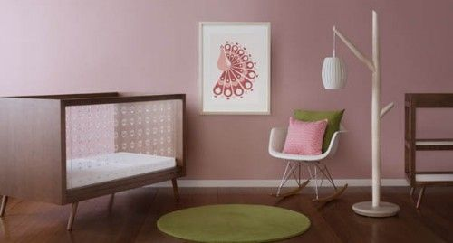 I'm usually not a fan of pink walls, but this is nice...more of a dusty rose. Love green, pink and brown together.