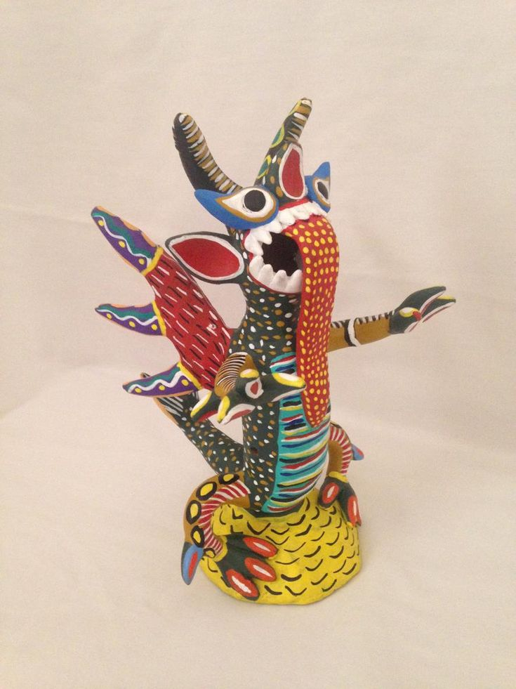 Green Alebrije - A unique painted clay from the beautiful state on the Pacific Coast of Mexico, Michoacán.