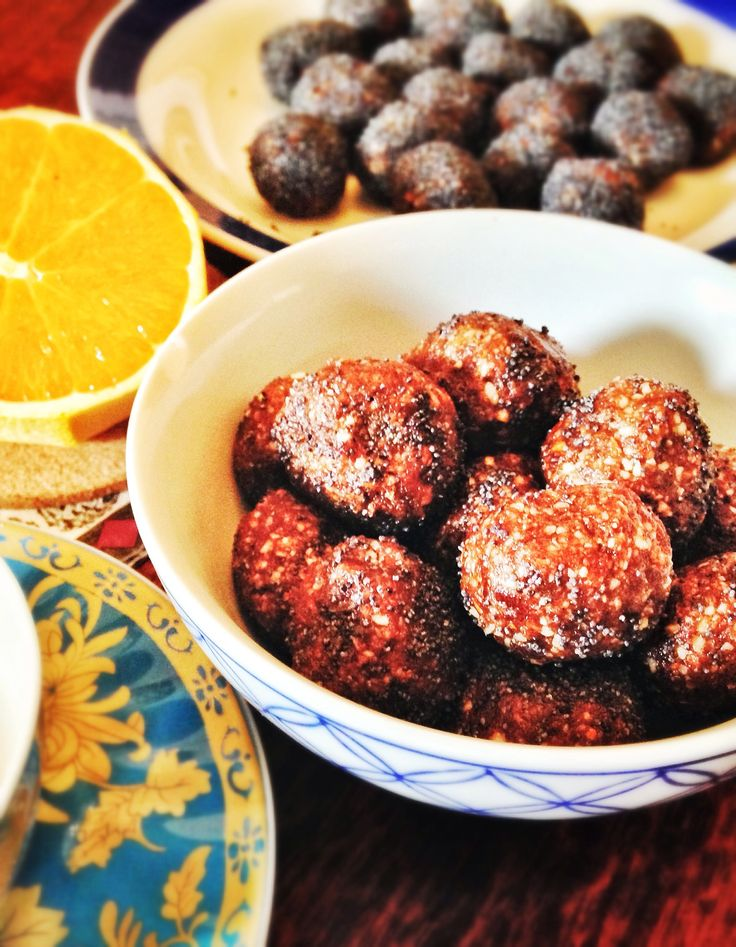 Orange and poppy seed bliss balls. A healthy gluten free, dairy free snack filled with almonds, orange zest and cocoa or cacao. Keeps tummys full, delicious as an afternoon snack with a cup of tea, and the kids love them too. Recipe... http://www.eatraiselove.com/eat/chocolate-orange-poppy-seed-bliss-balls/