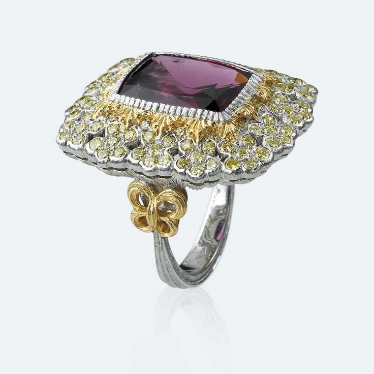 Cocktail ring with red spinel embedded in the play of lights created by diamonds arranged like a flower and by finely inlaid yellow and white golds. Some believe that this gem has the power to attract wealth, prosperity and health. Others think that it can strengthen the intellect and memory  Http://www.facebook.com/diamonddreamfinejewelers http://www.twitter.com/diamond_dream_ http://www.instagram.com/diamonddreamjewelers