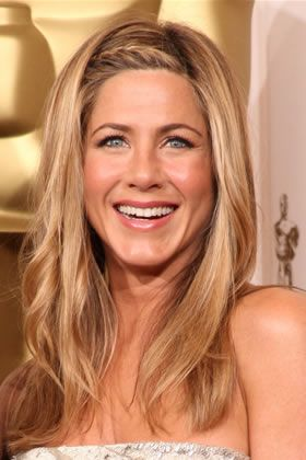 Jennifer Aniston made boho braiding work with an incredibly glamorous beaded gown.