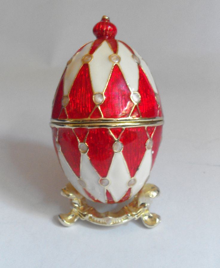 11554 £20 inc UK Post. Offers welcome. Decorative egg shaped Harlequin design ring, pill or trinket box, with presentation box and leaflet