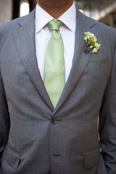 Bestmen, ushers and fathers. Sage green ties. We don't like this buttonhole, would prefer to be more similar to the grooms