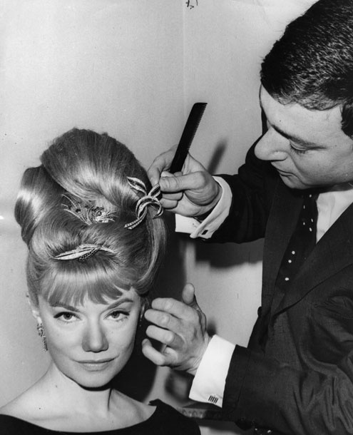 April 1963  South African opera singer Denny Dayriss gets her hair dressed with £10,000-worth of diamonds by Sassoon at his salon in London to sing at a charity ball at the Dorchester Hotel. The event raised funds for the White Fleet, an organization that converted former navy vessels into hospital ships that were despatched to disaster areas.