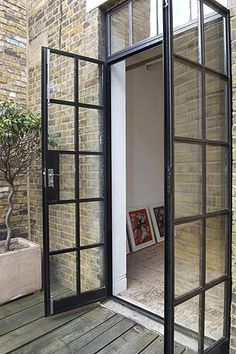 old factory french doors. I love these doors. I'd rather have these than sliders.