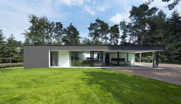 designed by rotterdam-based architectural practice 123DV, inhabitants of the 'villa veth' in hattem of the netherlands may  gaze into the dense woodland surrounding their residence. a curved glass wall encloses the common areas of this dwelling,  allowing the space to visually transcend its boundary into the landscape. supported with a single column clad with reflective metal,  the low-profile roof extends to cover an outdoor patio.