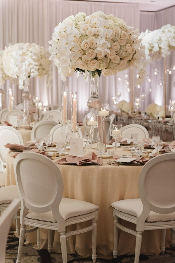 Glamorous white rose tall centerpieces: http://www.stylemepretty.com/california-weddings/dana-point/2016/04/25/glamorous-ballroom-wedding-thats-got-florals-for-days/ | Photography: Jana Williams - http://jana-williams.com/