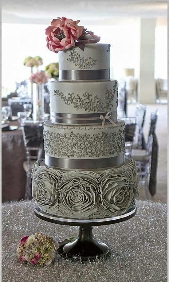 Silver lining wedding cake with single pink blossom - gorgeous!