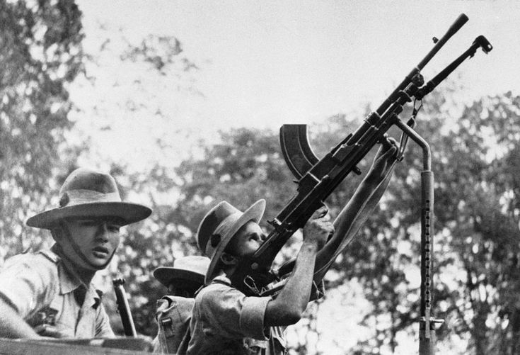 Gurkhas take to jungle warfare in Malaya on Dec. 17, 1941 and show extraordinary skill in concealment and surprise attack.(AP Photo)