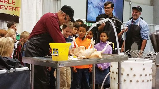 """""""Teaching Young People Ethical Animal Slaughter""""Animal slaughter demonstrations, like Joel Salatin's poultry processing, teach children that to ethically eat meat they must respect sentient animals, reject the slaughterhouses and factory farms, and embrace the cycle of life. From MOTHER EARTH NEWS Magazine"""