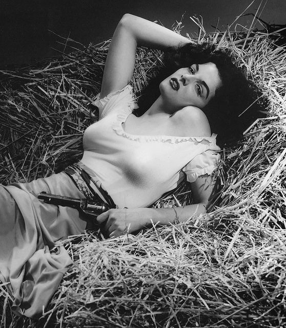 Jane Russell stacked in the haystack