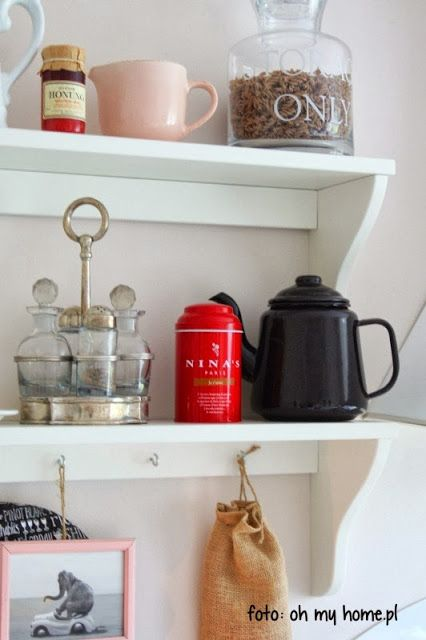 kitchen shelf with red, pink and black