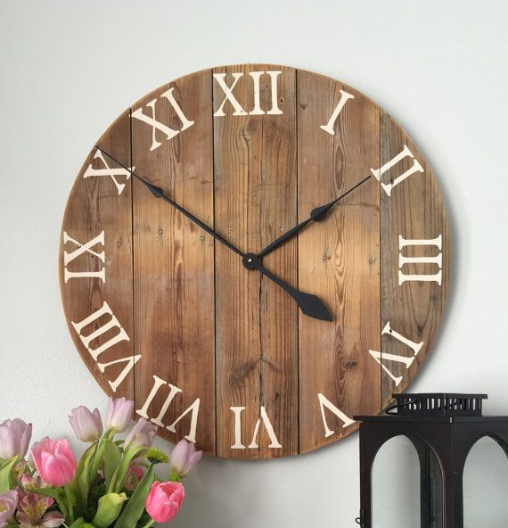 Large wooden wall clock made from pine boards. Wood comes from barn siding that is mildly weathered and still in great condition.  • Made in the
