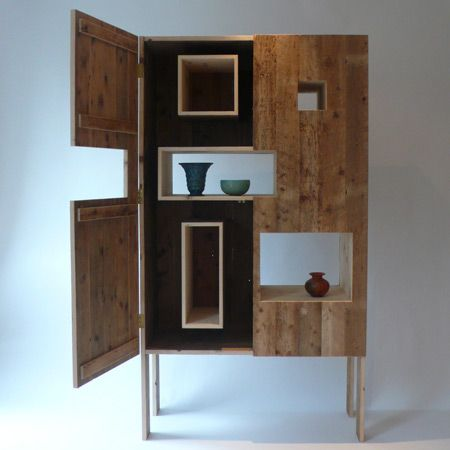 London designer Nina Tolstrup of Studiomama has created a cabinet with hidden compartments made of reclaimed floorboards.