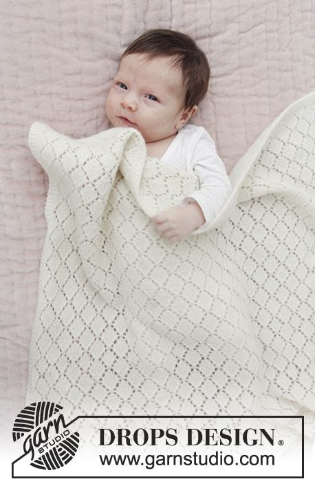 Baby blanket with lace pattern. The piece is knitted in DROPS Baby Merino. Free pattern by DROPS Design.