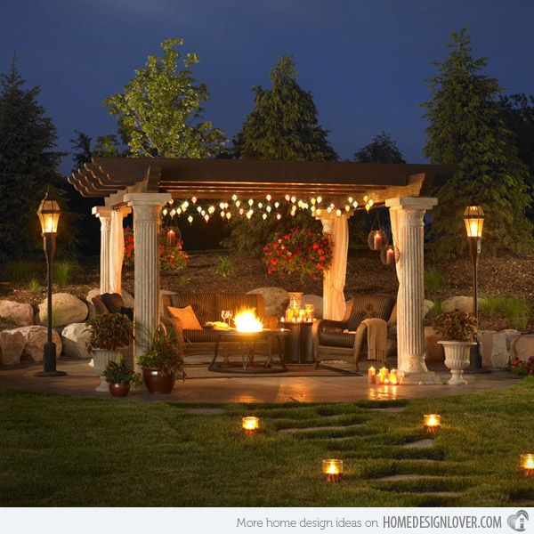 Exterior, Open Living Area in the Pergola : Open Living Room With Ionic Design And Strings Lamps On The Ceiling