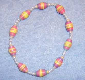 """Multi-colour beads are made out of 100% paper and coated with a non-toxic glaze for shine & durability. White spacer beads are plastic, so no worrying about glass beads breaking! Stringing material is stretch elastic for a little give when putting on & removing the bracelet! Diameter of the bracelet is 2.5""""."""